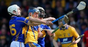 Clare's Brendan Bugler comes under pressure from Niall O'Meara and Patrick Maher of Tipperary in the Allianz Hurling League Division One  semi-final. Photograph: Cathal Noonan/Inpho