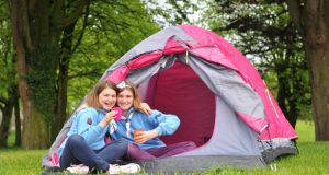 Ssisters Shauna (12) and Amy (14) Bowden  show off their camping skills. Photograph:  Ciara Wilkinson