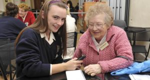 Sophia Kavanagh from the Dominican College, Wicklow, shows Vera Webster what her moblie phone can do for her.