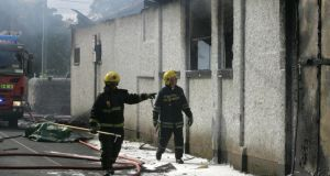 Firefighters at the scene of the blaze in 2007 in which two firefighters died