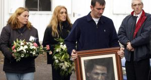 Family members carry flowers and a picture of their mother Jean McConville. Mrs McConville, 37, was abducted and murdered by the IRA in 1972. Photograph: Paul Faith/PA Wire