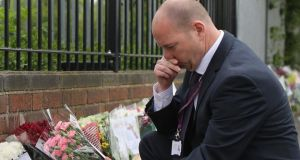 Steve Mort, head teacher of Corpus Christi Catholic College, reads the hundreds of tributes left in honour of slain teacher Ann Maguire on April 30th, 2014 in Leeds, England. A 15-year-old male student has been arrested in connection with the death of teacher. Photograph: Christopher Furlong/Getty Images