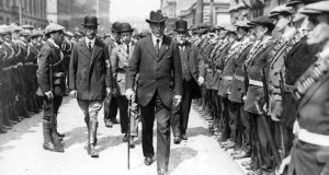 1914: Edward Carson inspects a parade of armed Ulster Volunteers. By the time Carson announced in Belfast that an Ulster Division would be formed from the UVF, many young men, impatient with waiting, had already enlisted.  Photograph: Central Press/Getty