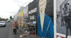 Work continues on a mural depicting Gerry Adams on the Falls Road, in Belfast today. Photograph: PA