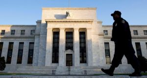 "The US Federal Reserve will see the buoyant employment figures as vindication of its decision to continue reducing or ""tapering"" its asset buys at a rate of $10 billion a month. Photograph: Reuters/Larry Downing"