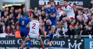 Leinster's Zane Kirchner and Tommy Bowe of Ulster vie for possession at Ravenhill.  Photograph: Dan Sheridan / Inpho