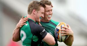 Eoin Griffin celebrates with Connacht's first try scorer Matt Healy during the RaboDirect Pro12 game against Cardiff Blues at the Sportsground in Galway.  Photograph: James Crombie/Inpho