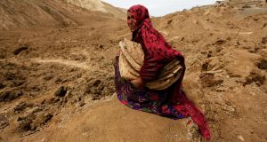 An Afghan woman who lost her family in a landslide at the Argo district in Badakhshan province. Photograph: Mohammad Ismail/Reuters