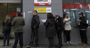 """Despite the brightening economic picture, unemployment remains stubbornly high across Europe, particularly in the under-25 demographic."" Above: a queue outside an unemployment office in Madrid. Photograph: Andres Kudacki/AP"