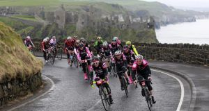 Cyclists make their way past Dunluce Castle, on the Antrim coast, Northern Ireland, to celebrate the arrival of the Giro d'Italia cyclists. Photograph: Peter Morrison/AP