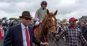 Ruby Walsh returns on Annie Power with owner Rich Ricci (left) after winning Saturday's Irish Stallion Farms European Breeders Fund Mares Champion Hurdle at Punchestown.