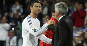 Real Madrid coach Carlo Ancelotti with  striker Cristiano Ronaldo.