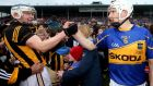 Tipperary's Brendan Maher exchanges greetings with Kilkenny's  TJ Reid after the National League final in Thurles. Photo: James Crombie/Inpho
