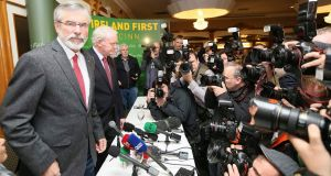 Sinn Féin president Gerry Adams arrives at a news conference in Belfast after he was released from police detention tonight. Photograph: Paul Hackett/Reuters)