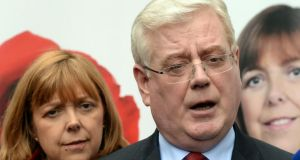 Eamon Gilmore (with Emer Costello): 'Any water charging should be based on usage so that households can have an incentive to conserve water but also can have a way of being able to reduce their bill.' Photograph: Cyril Byrne