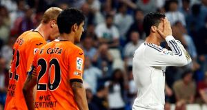 Real Madrid's Cristiano Ronaldo reacts after missing a chance to score a late winner against Valencia last night. Photograph: Sergio Perez/Reuters