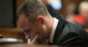 Olympic and Paralympic track star Oscar Pistorius sits in the dock in the North Gauteng High Court in Pretoria today, 2014. Pistorius is on trial for murdering his girlfriend Reeva Steenkamp at his suburban Pretoria home on Valentine's Day last year. Photograph: Reuters
