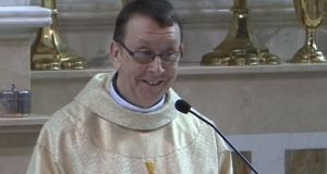 The video of Fr Ray Kelly singing at a wedding has gone  worldwide and was viewed 34 million times on YouTube.