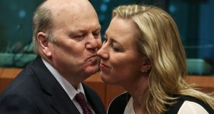Minister for Finance Michael Noonan and Finnish finance minister Jutta Urpilainen chat at the start of eurogroup finance ministers' meeting  in Brussels yesterday. Photograph: EPA/Julien Warnand