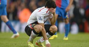 Liverpool's Luis Suarez appears dejected after the final whistle of the Premier League match at Selhurst Park, London.  Photograph: Adam Davy/PA Wire.