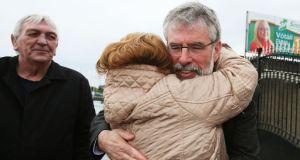 Sinn Fein Leader Gerry Adams receives a hug from a well wisher outside Sinn Fein offices on the Andersonstown Road, Belfast on Monday. Photograph: PA