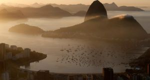 A view of the Sugar Loaf mountain, as the sun rises in Rio de Janeiro this morning. Photograph: /Sergio Moraes/Reuters