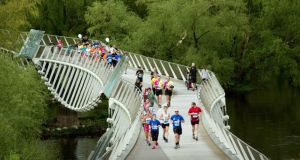 Living bridge: the Barrington's Hospital Great Limerick Run started at the People's Park surrounded by Georgian Limerick and wound its way through historical, sporting and cultural sites, such as the Treaty Stone and Thomond Park Stadium before finishing on  O'Connell Street. Photograph: Seán Curtin/FusionShooters