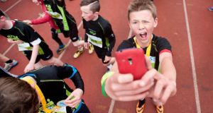 Snappy, happy: 12-year-old Alan Shanahan from Newcastle West takes a  selfie after completing the UL Sport Kid's Run  at the University of Limerick on Saturday. Photograph: Declan Monaghan/Fusionshooters