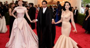 Dita Von Teese in a Zac Posen gown with four leaf clover shaped skirt, Zac Posen and Karen Elson is reminiscent of old-school glamour in a shiny, sheeny cap-sleeved Zac Posen gown in the palest shade of pink. Photograph: Getty Images