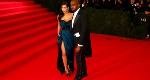 Kim and Kanye have evidently got over last year's Met Ball debacle with a Lanvin dress and suit. Note Kim nonchalantly sticking her hand in her pocket. Who, her, bothered? Photograph: Getty Images