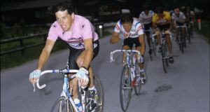 Stephen Roche in the Giro d'Italia leader's jersey in the Dolomites, climbing during Roche's first day as race-leader of the race, where Italian fans jeered and even spat at Roche because he'd beaten his own Italian team-mate Roberto Visentin. Photograph: Graham Watson