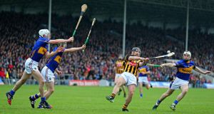 Allianz Hurling League Division One  final, Semple Stadium: Kilkenny's Richie Hogan under pressure from Michael Cahill, Cathal Barrett and Brendan Maher of Tipperary. Photograph: Cathal Noonan/Inpho
