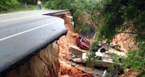 Vehicles rest at the bottom of a ravine after the Scenic Highway collapsed near Pensacola, Florida last week. Photograph: AP Photo