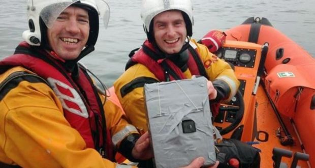 Members of Baltimore Inshore Lifeboat, Conor Dempsey and Pat O'Driscoll, with the recovered camera belonging to pupils from Terence MacSwiney College.