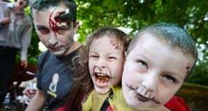 Walking undead: Ciaran, Grainne and Eoin Meghen from Killiney taking part in the Dublin Zombie Walk,  in aid of the Irish Cancer Society and Barnardos, in August 2012. Photograph: Alan Betson/THE IRISH TIMES