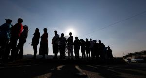 Voters queue to cast their ballots in Johannesburg's Alexandra township.   Photograph: Reuters