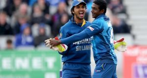 Sri Lanka wicket-keeper Dinesh Chandimal celebrates with Ajantha Mendis after Ireland captain William Porterfield was caught by Kusal Perera off the spinner's bowling during the RSA Insurance One-Day International in Clontarf. Photograph:  James Crombie/Inpho