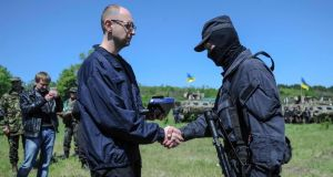 Ukraine's Prime Minister Arseny Yatseniuk greets a security personnel member as he arrives to inspect the Ukrainian military grouping near Slaviansk in eastern Ukraine on Wednesday. Photograph: Reuters