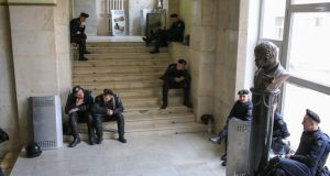 Ukrainian policemen rest inside of a regional state administration building as pro-Russian protestors outside have their rally to mark International Labour Day in front in Kharkiv, Ukraine, earlier this month. Photograph: EPA