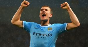 Manchester City forward Edin Dzeko celebrates scoring his first goal  in the  Premier League match against Aston Villa at Etihad Stadium. Photograph: Michael Regan/Getty Images