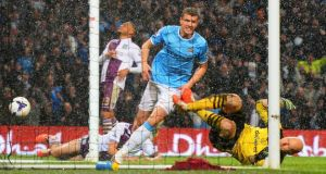 Edin Dzeko of Manchester City celebrates scoring the opening goal during their Premier League match against Aston Villa at Etihad Stadium, Manchester. Photograph:  Michael Regan/Getty Images