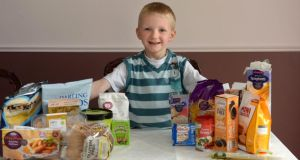 Callum Maguire shows off his gluten-free range of food. Photograph: Dara Mac Dónaill