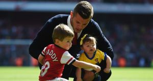 Jack Wilshere  with his daughter Delilah and son Archie on the pitch following the Barclays Premier League match between Arsenal and West Bromwich Albion at the Emirates Stadium will return for final game of the season against Norwich. Photograph:   Shaun Botterill/Getty Images
