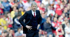 "Arsenal's manager Arsene Wenger: ""That's a basic question you have to answer in England. Do we let it go and everyone spends what he wants?"" Photograph: Facundo Arrizabalaga/EPA"