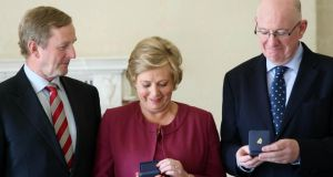 Newly-appointed Minister for Justice, Equality and Law Reform, Frances Fitzgerald, newly-appointed Minister for Children, Charlie Flanagan and Taoiseach Enda Kenny at Aras an Uachtarain where the ministers received their seals of office.  Photograph: Colin Keegan, Collins Dublin.