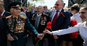 Russian second World War  veterans after laying flowers at the Tomb of Unknown Soldier outside the Kremlin, in Moscow, on Thursday. Russia marks the 69th anniversary of the victory over Nazi Germanyin WWII on 09 May , on Friday. Photograph: Yuri Kochetkov/EPA