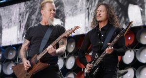James Hetfield (left) and Kirk Hammett of Metallica performing during the Live Earth Concert at Wembley Stadium. The veteran US rockers have been announced as the Saturday night headliners for this year's Glastonbury festival. Photograph: Yui Mok/PA Wire