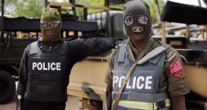 Nigerian police prepare for  a patrol. Photograph: Quentin Leboucher/AFP/Getty Images