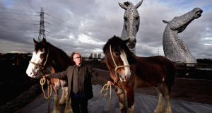 Andy Scott with Clydesdale horses in front of his 'The Kelpies'. Photograph: Jeff J Mitchell/Getty Images