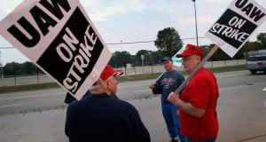 United Auto Workers (UAW) picket outside General Motors. Union membership uin the US had declined rapidly as had income equality.